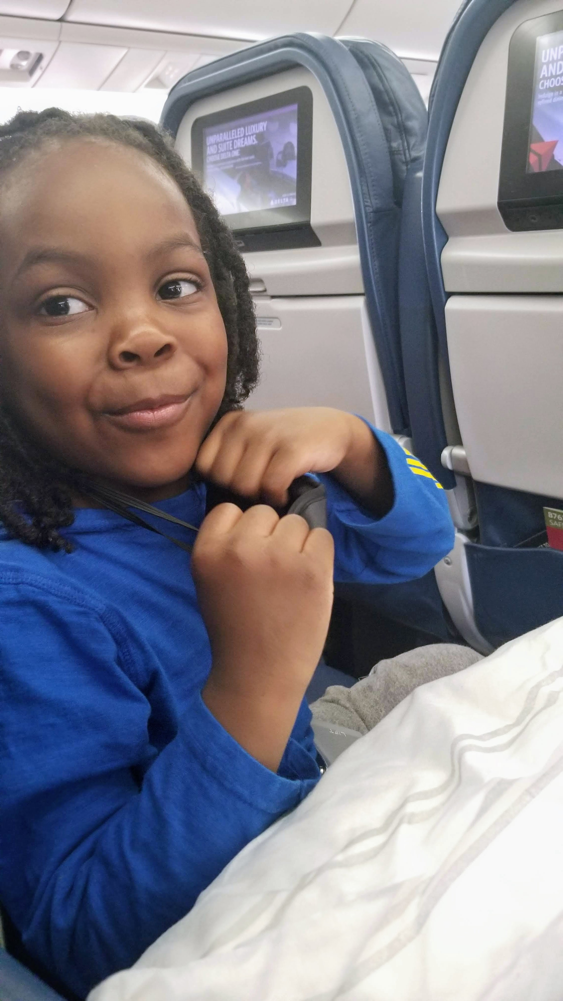 black family on a plane