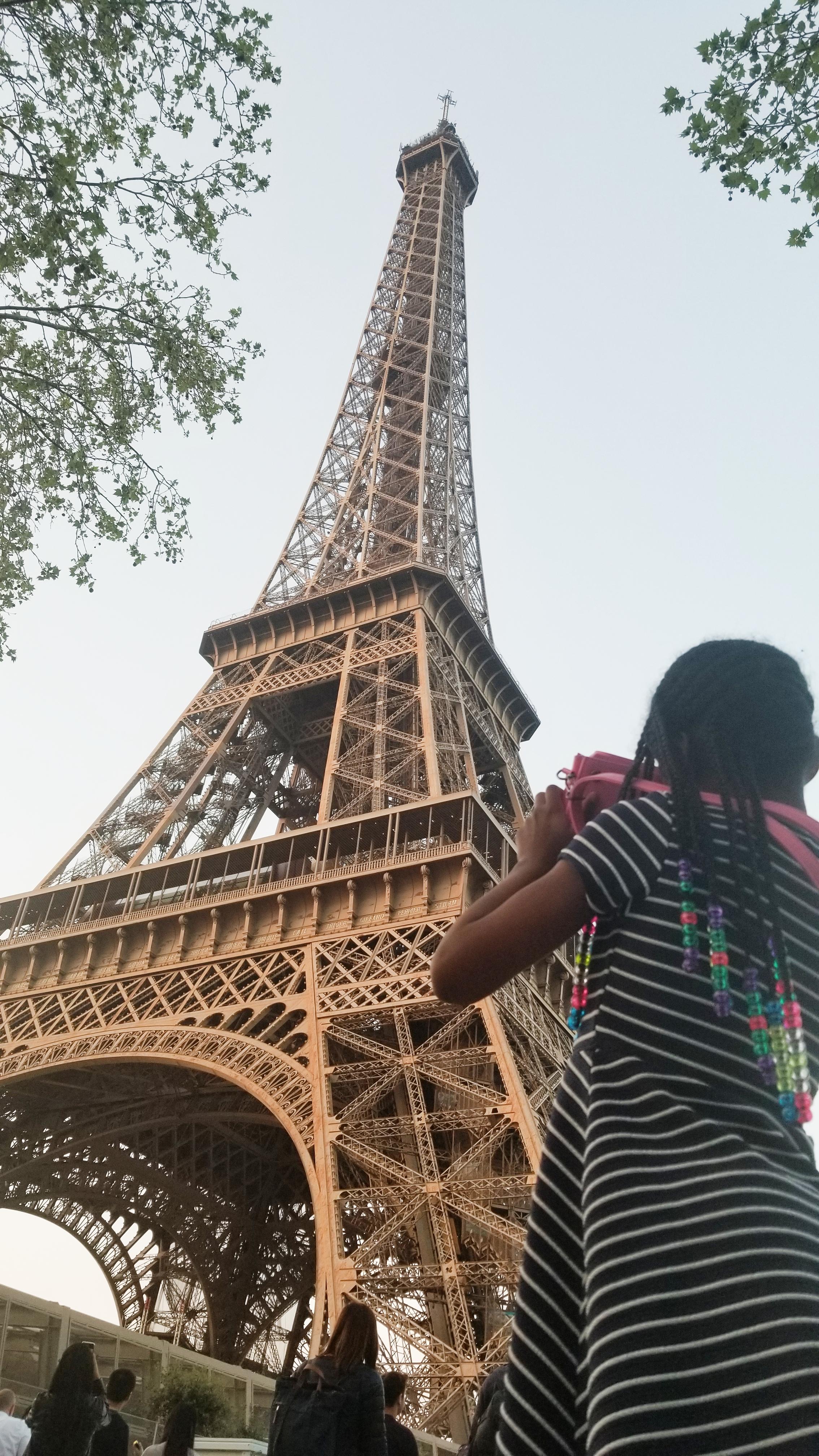 black kid at the Eiffel Tower